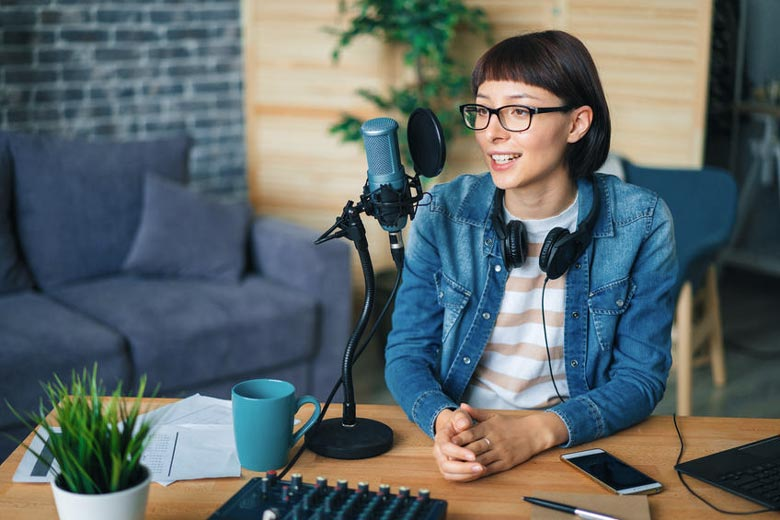 Woman using headphones for podcast